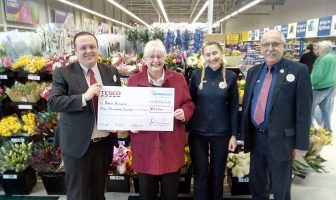 Picture of Dan Salisbury, customer service manager at the Exeter Vale Tesco Extra, presenting a cheque for £4,000 to Pete's Dragons chair of trustees Janet Ash. Also pictured are Tesco's Marta Marsweska and John Smith.