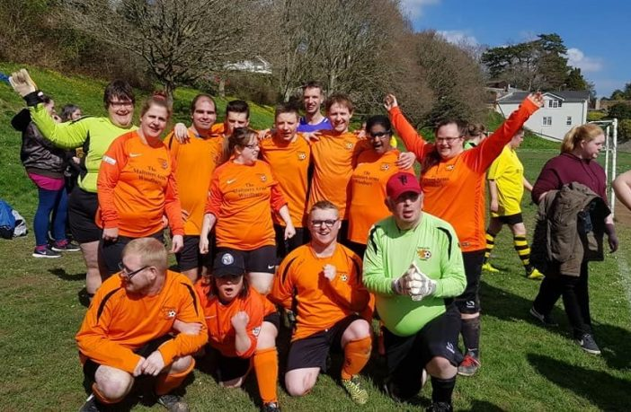 A photo of players from the Exmouth Tigers Disability Football Club.