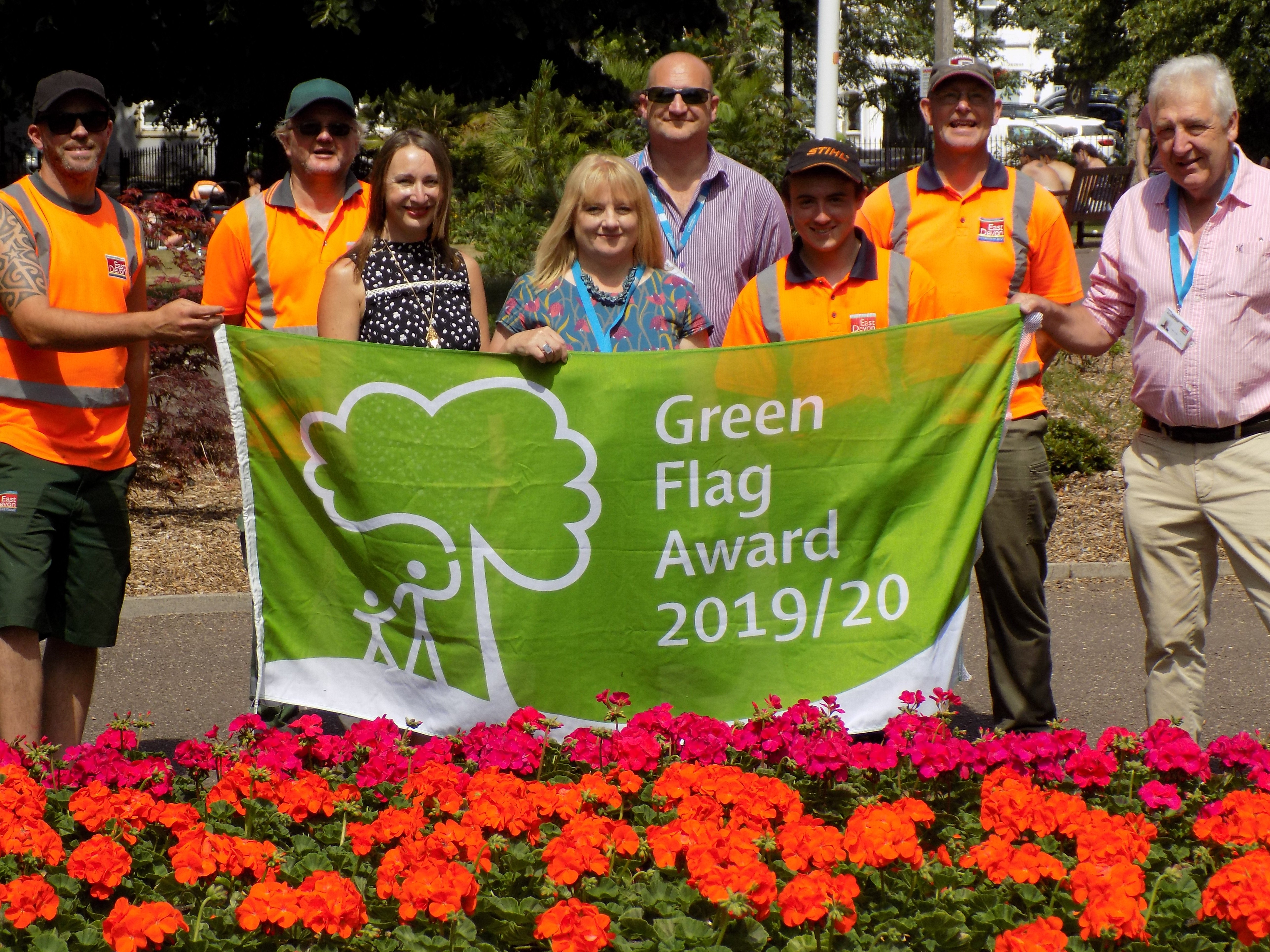 A Green Flag Award went to Manor Gardens, in Exmouth. (left to right): Andy Vinnicombe, Peter Hooker, Simon Kennedy, Andy Gordon-Raby (StreetScene), Cllr Jung, Lorna Christo (parks improvement officer), Sharon Scott, Luke Spiller (StreetScene) Photo: EDDC