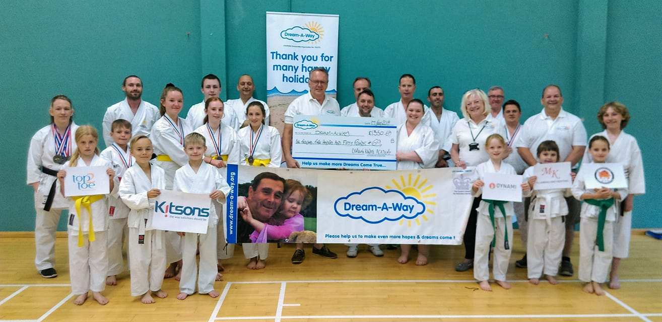 Exmouth Karate Academy members present a cheque to Dream-A-Way