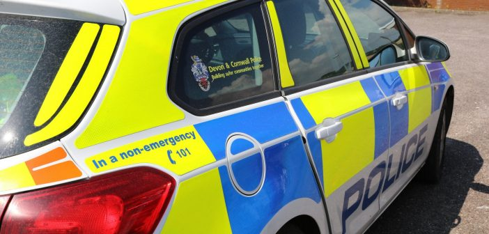 Police and ambulance called to car on its side near Honiton