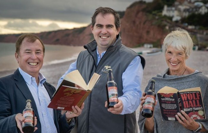 Malcolm Elliott, Budleigh Salterton Literary Festival chairman, with Jonathon Crump, director of Black Tor Brewery, and Jackie Collins, festival committee member. Picture: Jake Newman / Rekord Media.