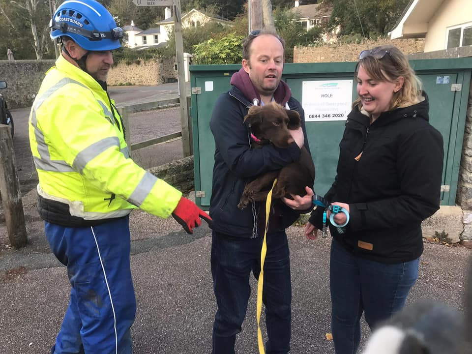 Spaniel Milly was reunited with her relived owners after a coastguard rescue effort. Picture: Beer Coastguard