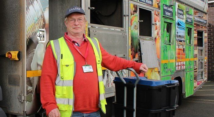 Cllr David Harvey with one of the new kerbside collection vehicles. Picture: Exeter City Council.