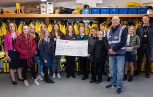 Students from Clyst Vale Community College present a cheque to Exmouth RNLI Lifeboat Fundraising Committee chairman Robin Humphreys.