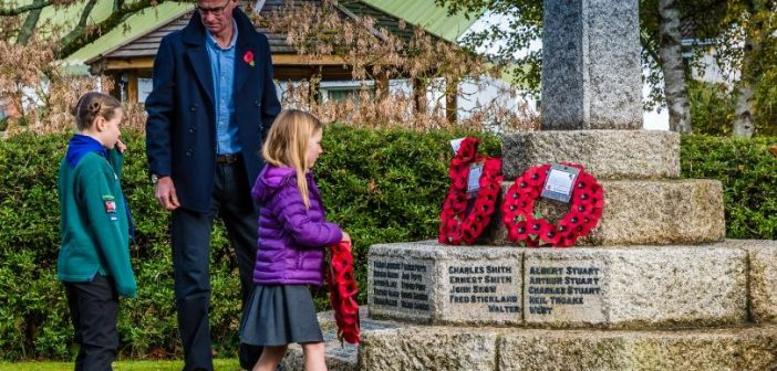 PHOTOS: Children lay Remembrance wreaths to honour East Budleigh's fallen