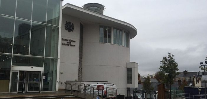 Exeter murder accused's neighbour tells court of 'awful' smell in building