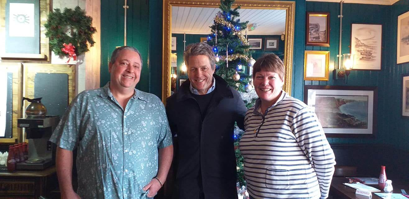 Nice to see Hugh: Film star Hugh Grant was a surprise visitor to The Swann Inn, Sidmouth. He is pictured with landlord and landlady Adrian and Julia Ricketts. Picture: The Swann Inn.