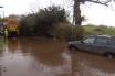 The flooded road in Warren Close, Payhembury. Image courtesy of BBC News Hub.