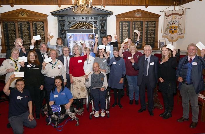Some 20 good causes were handed a total of £25,000 by Devonshire Freemasons at a presentation evening in Exmouth.