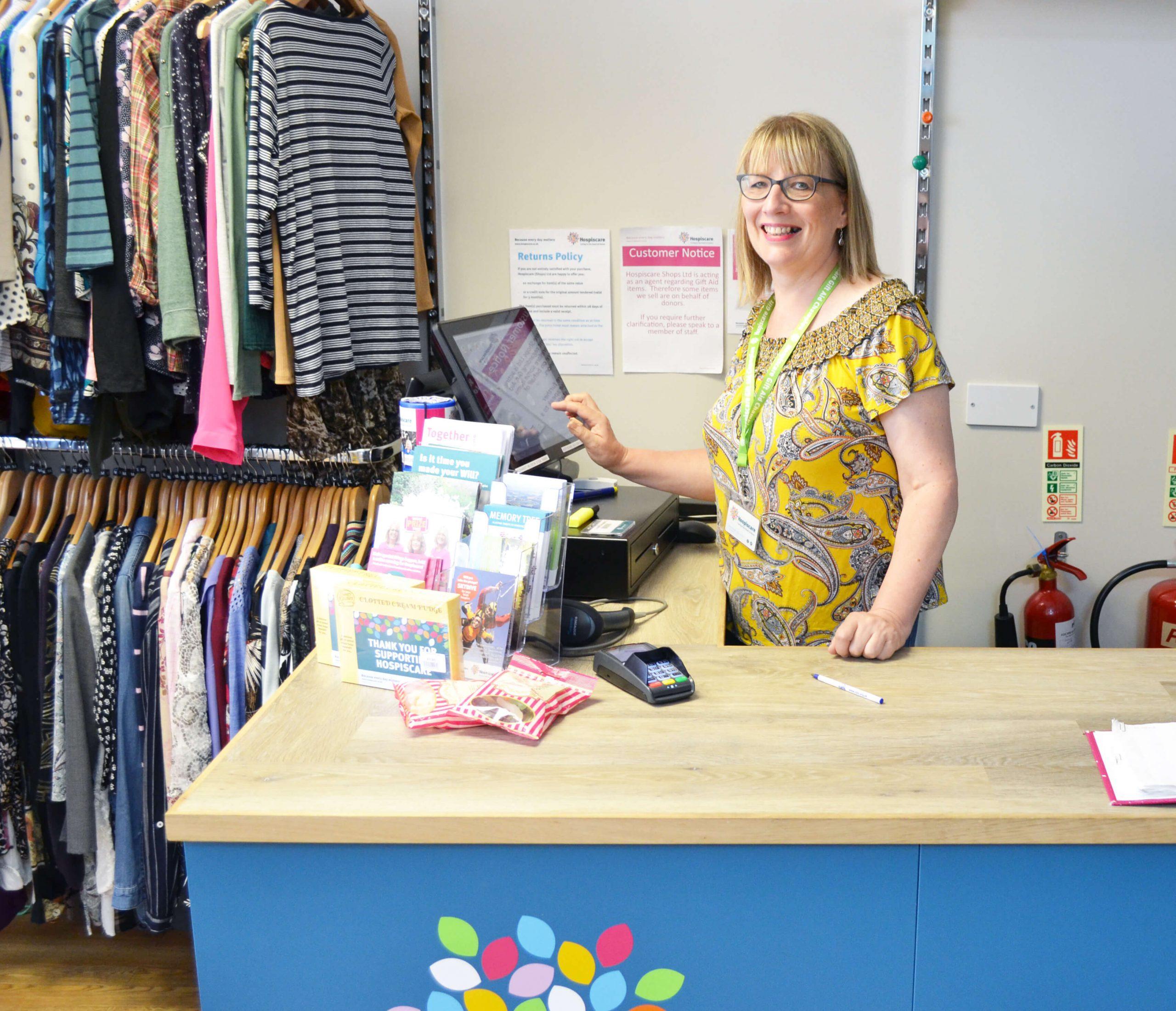 Liz Crosfield volunteering in her local Hospiscare shop in Seaton.