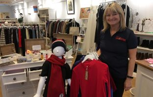 Louise Sherman, shop manager Retail Therapy in Rolle Street, Exmouth, with some of the stock Saltrock has donated to Pete's Dragons