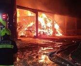 PHOTOS: Cows saved as firefighters from across East Devon battle huge barn blaze in Seaton