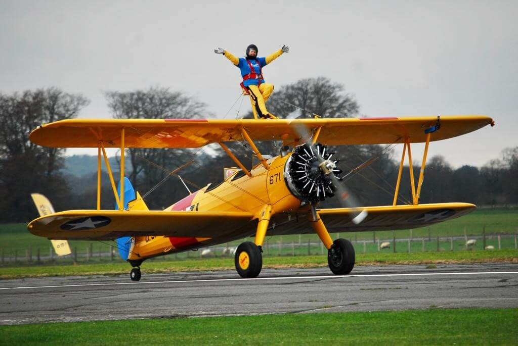 Ann Stirzaker, sales advisor at the Hospiscare shop in Topsham, taking part in the wing walking challenge.