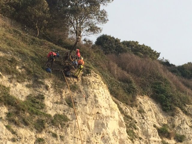 Contractors from Vertical Technology Ltd carry out work on the cliffs. Picture: East Devon District Council