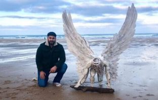 Artist Brendan Rawlings with 'Your Guardian Angel' which will be exhibited in Exmouth.
