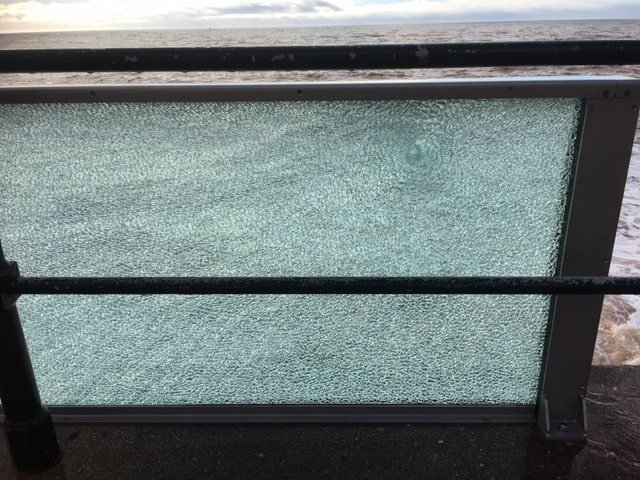 The smashed glass panel on Sidmouth seafront. Picture: EDDC