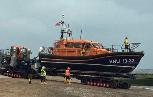 The Exmouth RNLI temporary all-weather lifeboat Bridie O'Shea launches for the search. Picture: Chris Sims / RNLI
