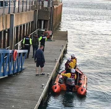 Exmouth: Police speak to the two individuals who were on board the vessel. Picture: Rob Vince/RNLI