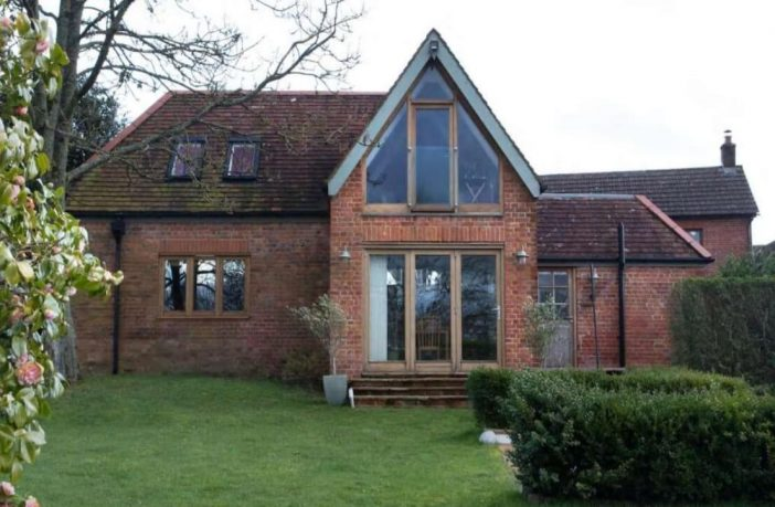 An image of the Coach House in Alfington shown to the East Devon District Council meeting.
