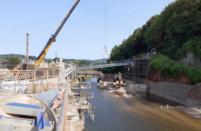 The new footbridge in Sidmouth has been lifted into position. Image: Carole Clark