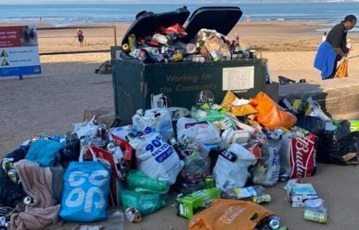 An overflowing bin on Exmouth seafront. Picture: EDDC