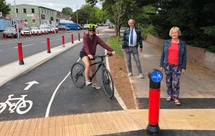 Commuter Abi Clark with councillors Stuart Hughes and Hilary Ackland on the E4 cycle route in Pinhoe, Exeter. Image: Devon County Council