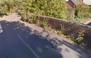 The railway bridge in Station Road, Broadclyst Station. Image: Google Maps