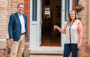 The Deaf Academy Exmouth Manager Vicky James receives the keys to the new children's home from Eagle One director Nick Hole Picture: Lily Holman
