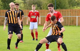 Action from the opening league game for Axminster Town, the 2-1 Tiger Way defeat to Dartmouth. Picture: Sarah McCabe