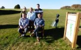 Axe Cliff golfers at the bench at the seventh tee donated in memory of Peter Motson. Picture Ace Cliff Golf Club