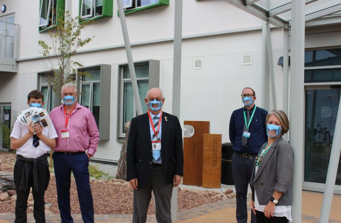 Exmouth (l-r) Oliver and Tim Phillips, Exeter Chiefs Foundation trustee Alan Quantick, Deaf Academy assistant principal Mark Stocks and fundraising appeal manager Sarah Shaw. Picture: The Deaf Academy