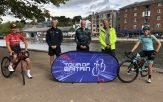 Exeter (l-r) Freddie Scheske; Chris Brown of British Cycling; Councillor Stuart Hughes; Hugh Roberts, Tour of Britain MD; and Natasha Reddy. Image: Devon County Council