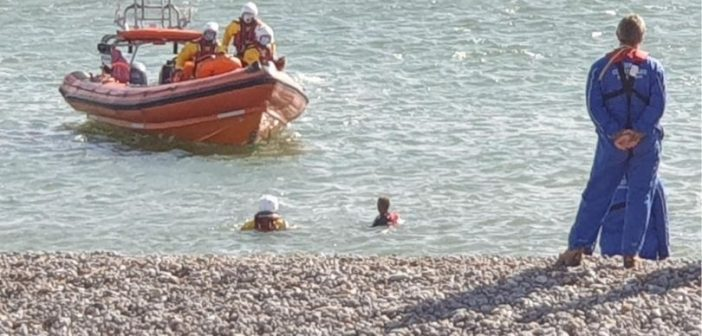 Windsurfer drifting out to sea off Seaton is rescued by Lyme lifeboat