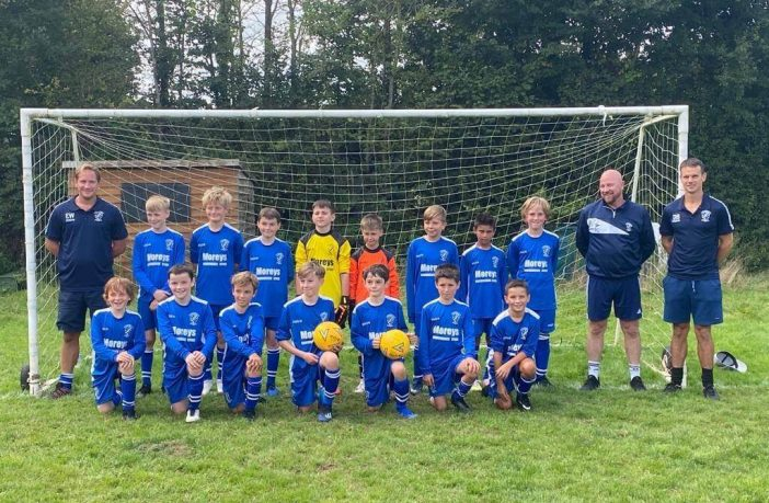 Brixington Blues U11s with their coaches ahead of the Exeter and District Youth League game against Dawlish. Picture: Brixington Blues Football Club