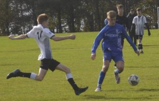 Brixington Blues U16s player Adam Watts in action against CS Cougars. Picture: Dave Haggerty