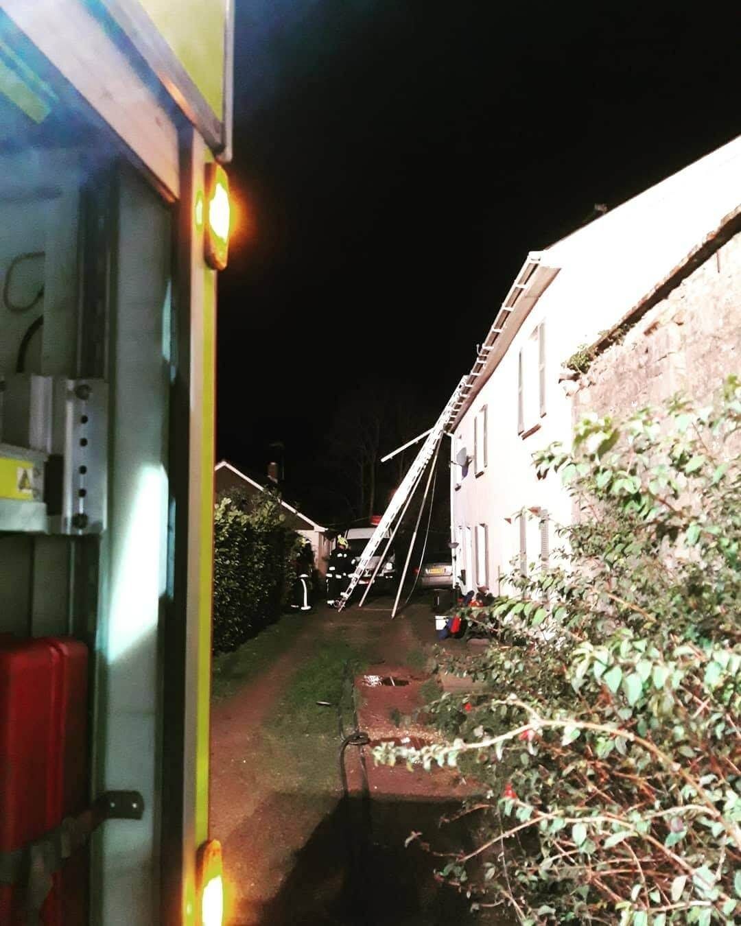 Crews tackle the chimney fire in Woodbury. Picture: Exmouth Fire Station