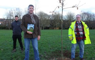 Photo competition winner Paul Osborne (centre) with Simon Putt of Devon Tree Services (left) and Cllr David Harvey (right). Image: Exeter City Council