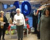 Loyal volunteer toasts 10 years of Children's Hospice South West charity shop success in Honiton