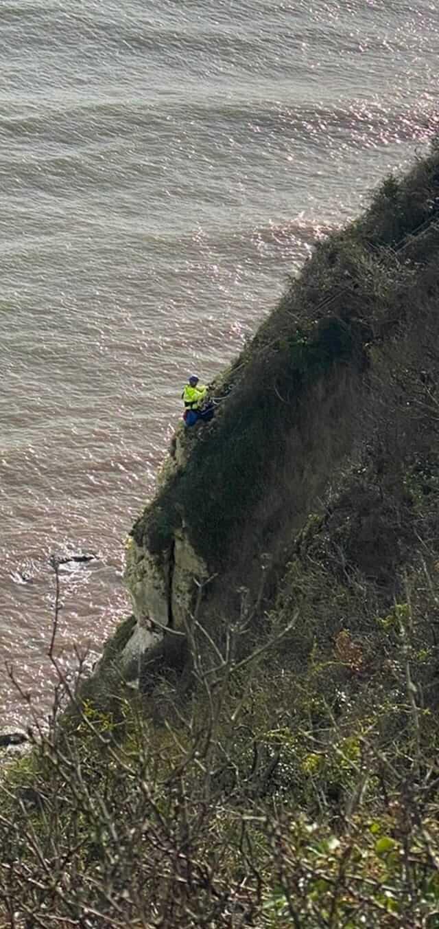 East Devon A coastguard rescuer descend the cliff to reach the casualty. Picture: Beer Coastguard