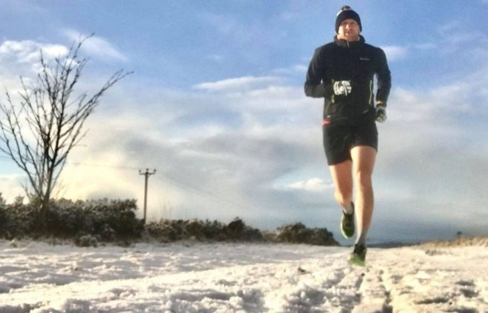 Sidmouth Running Club member Dan Prettejohn running in the snow.