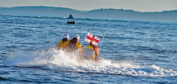 Paddleboarders swept nearly a mile out to sea are rescued by Exmouth RNLI