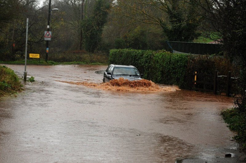 Flooding next to Tipton St John Primary School. Image: Devon County Council
