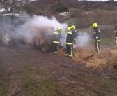 Fire crews use water tanks to bring tractor blaze under control in field at Farway