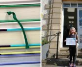 Tiana, seven, scoops gold at Ottery Library for reading 100 books